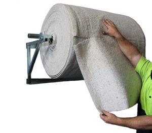 Absorbent roll matting on wall bracket dispenser