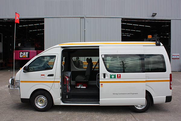 Mini bus with vehicle safety flag, fire extinguisher, reflective tape, first aid and light bar.