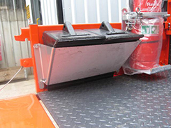 Wheel chock mounted in tray